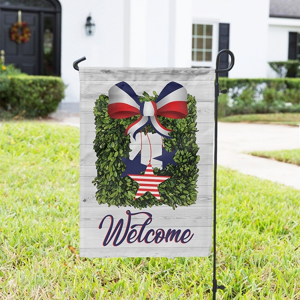 USA Boxwood Wreath with Bow Garden Flag-one-sided with Welcome in patriotic red white and blue colors.