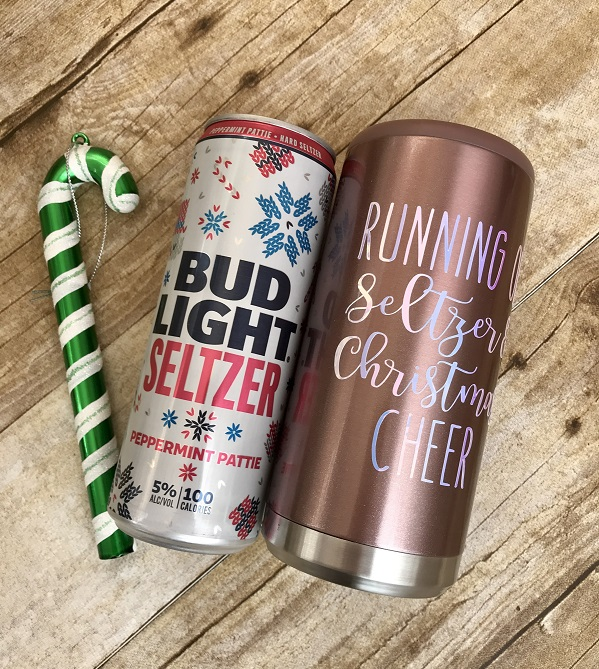 Skinny Can Insulated Cooler-rose gold with white wording next to a Bud Light seltzer can